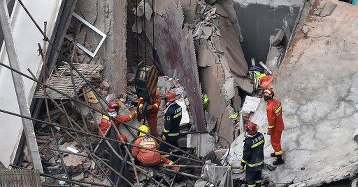 China: At least nine people believed to be trapped after building collapsed in Shanghai