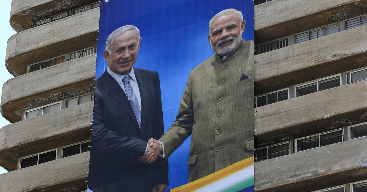 Israeli PM Benjamin Netanyahu's party displays election banners featuring him with Narendra Modi