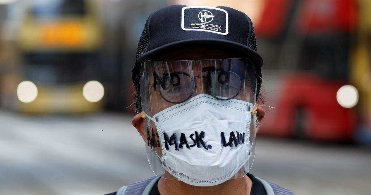 Hong Kong invokes colonial-era emergency law to ban face masks in public, but protests continue
