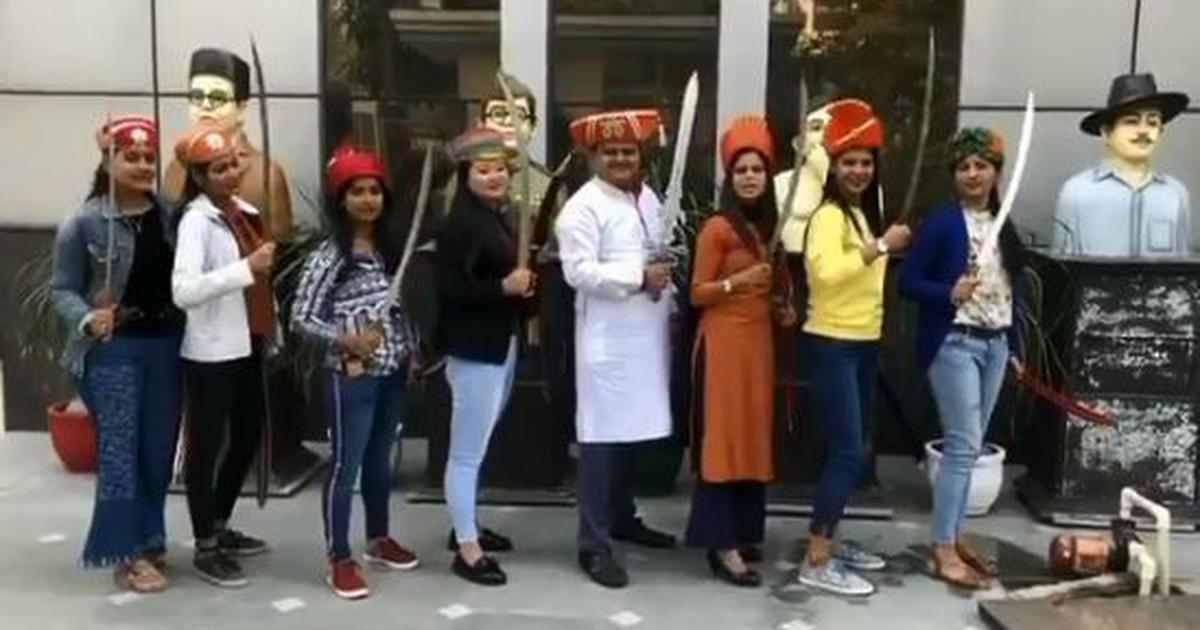 Watch: Sudarshan News employees brandish swords to celebrate self-proclaimed win over JNU students