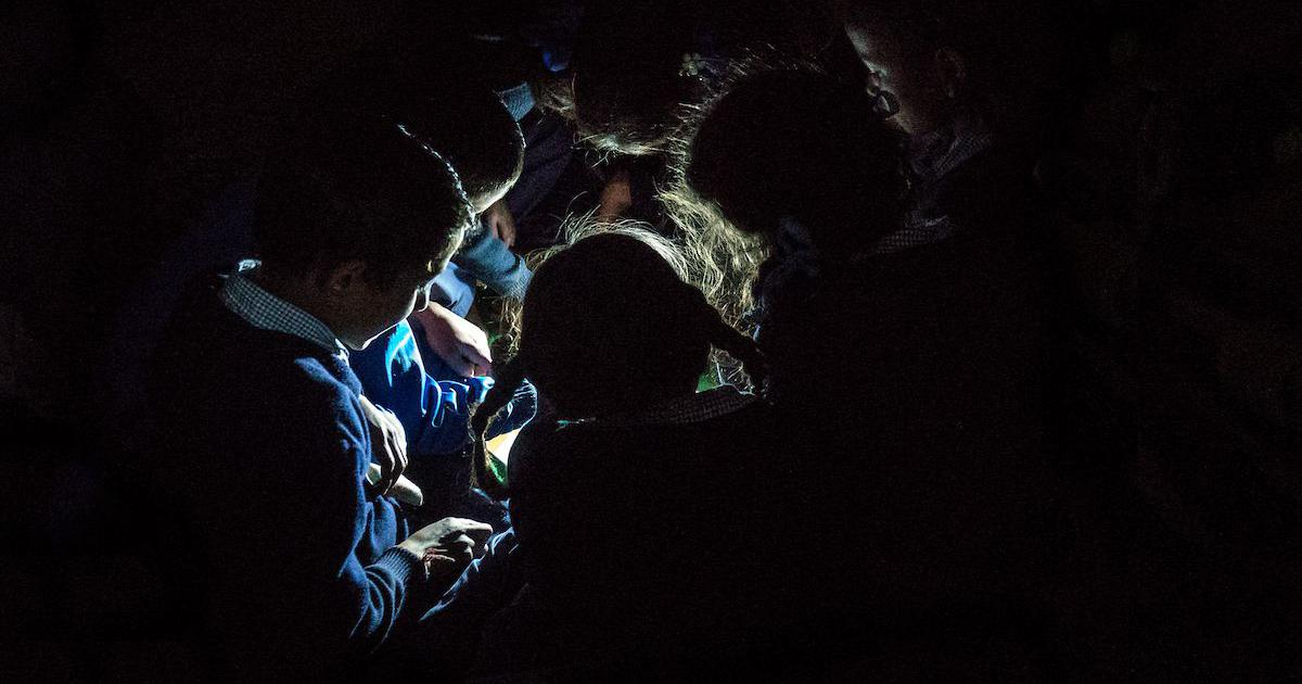The Art of Resistance: 'Children Reading around Solar Lamp' radiates resilience and hope