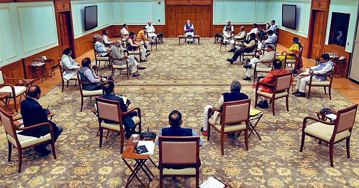 In photos: Social distancing seen at Cabinet meeting chaired by Modi, at shops across country