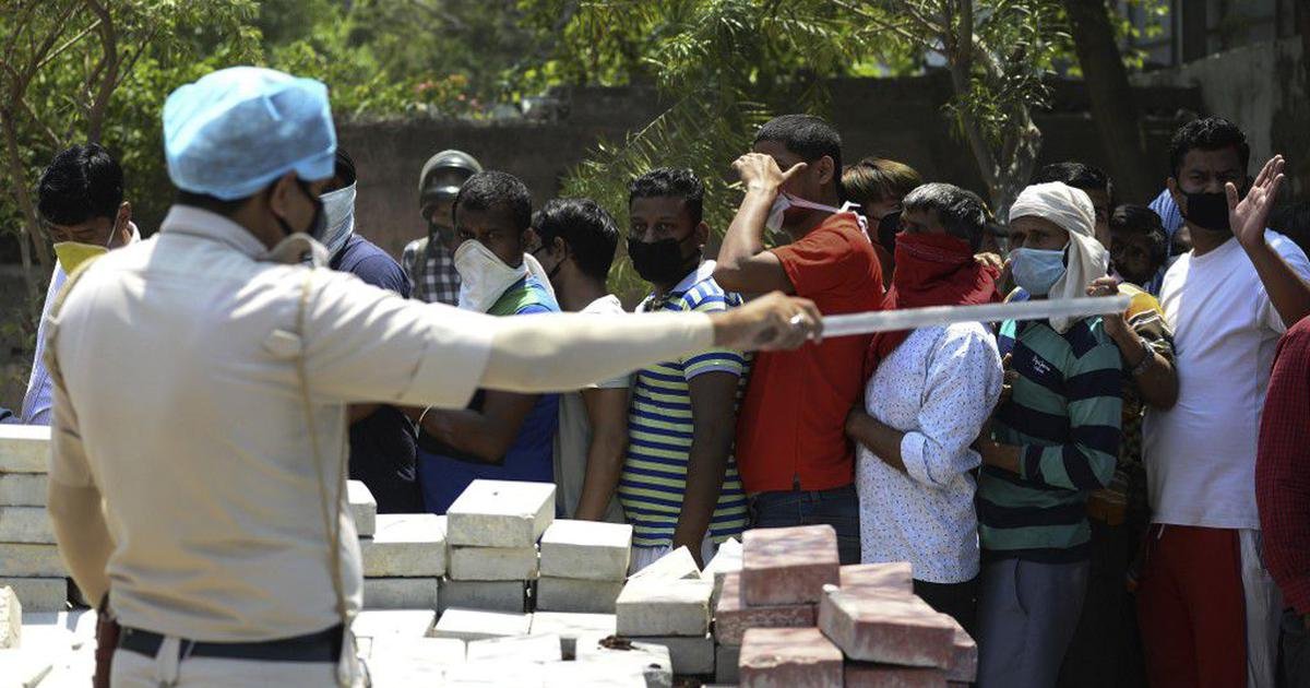 Covid-19: Huge crowds seen outside Delhi liquor shops even after government increases prices