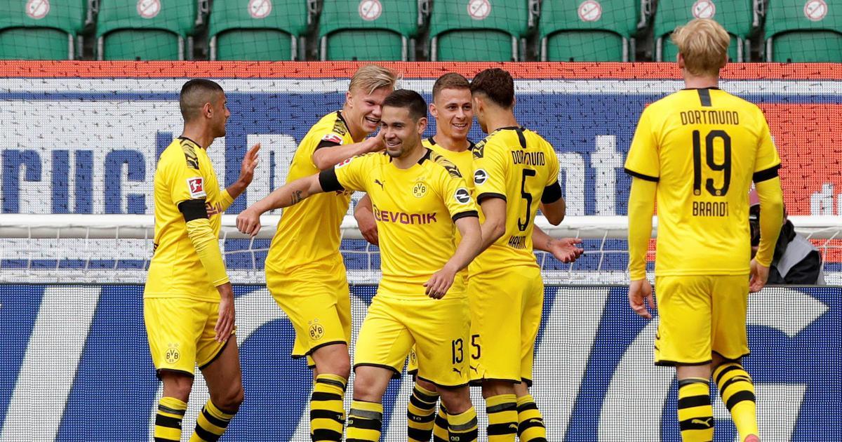 Bundesliga: Borussia Dortmund beat Wolfsburg 2-0 to keep pace with Bayern Munich in title race