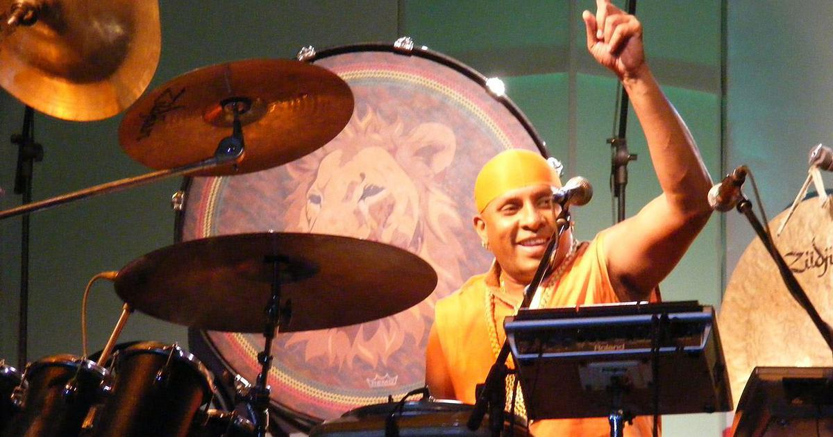 What is Sivamani doing in between trying to be the 'world's best drummer'?