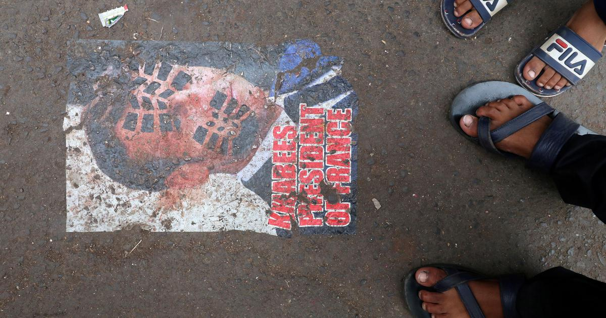 Posters against French president pasted on Mumbai road amid row over his comments about Islam