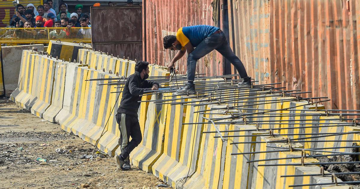 Farm laws: At Delhi's borders, police use concrete barriers, razor wires to block farmers