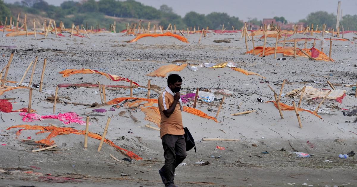 In UP's Prayagraj, shrouds removed from shallow graves along the Ganga, say reports