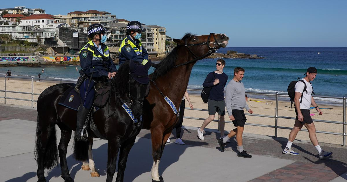 Covid: Sydney seeks military help to enforce curbs as city records sharpest single-day rise in cases