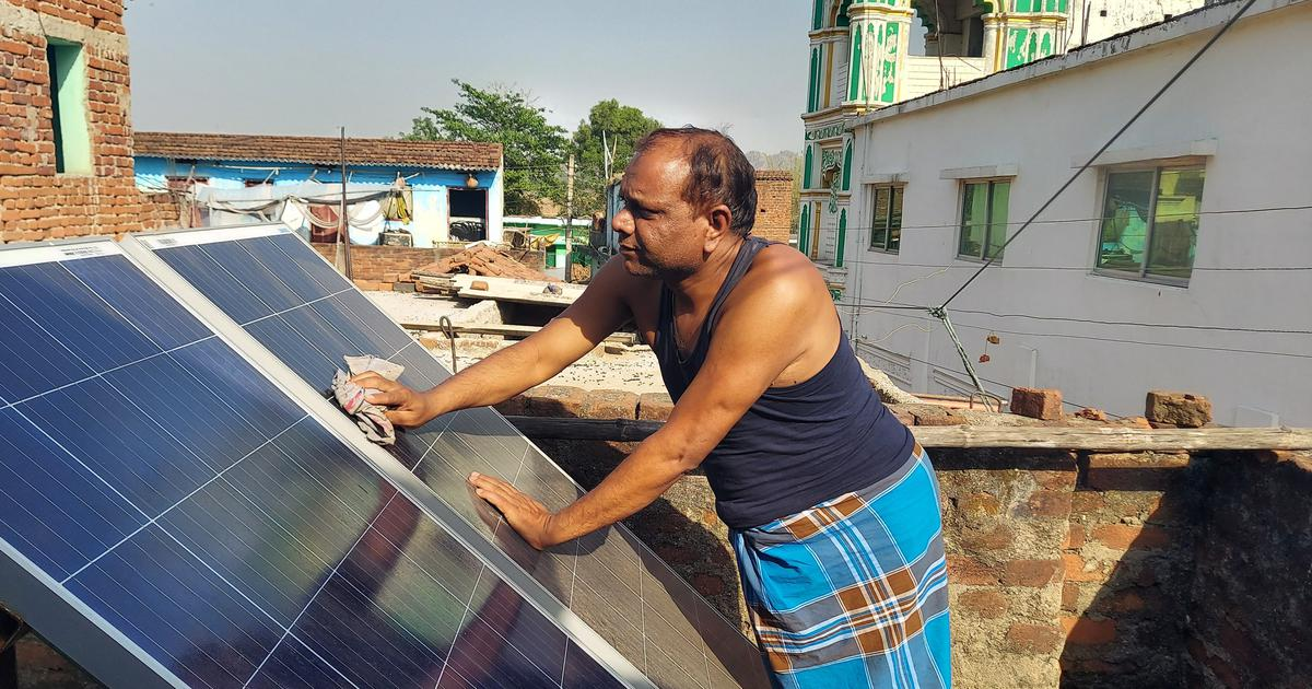 Two solar panels on a tailor's roof tell the story of how Jharkhand is adopting renewable energy