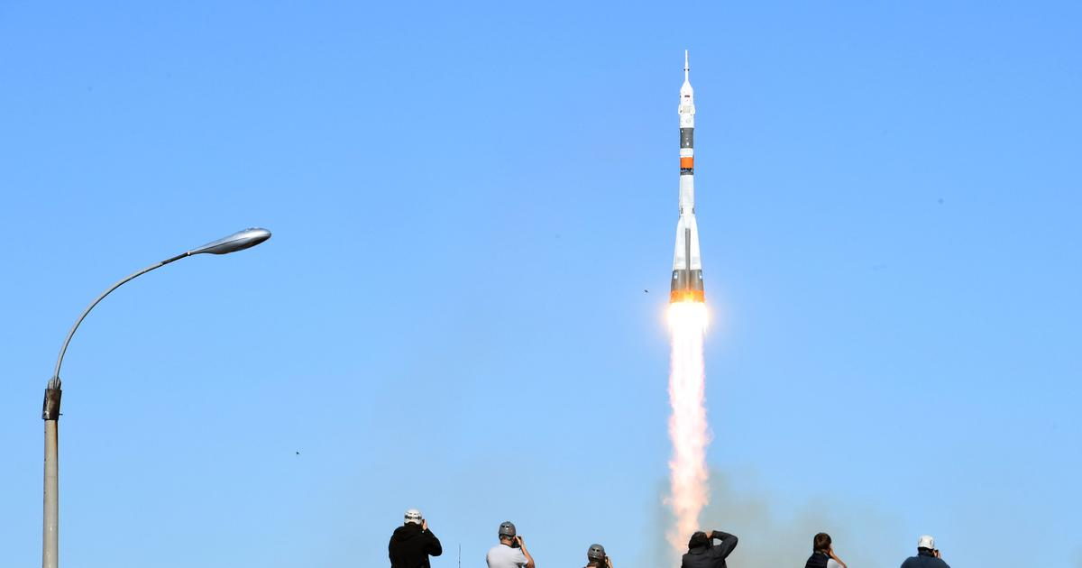 U.S., Russian astronauts make emergency landing after booster rocket fails