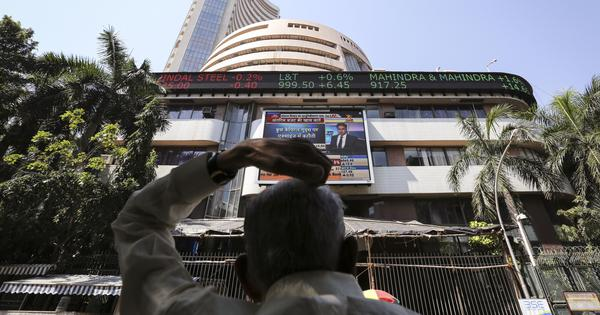 Sensex, Nifty close slightly higher after erasing most gains made in morning trade