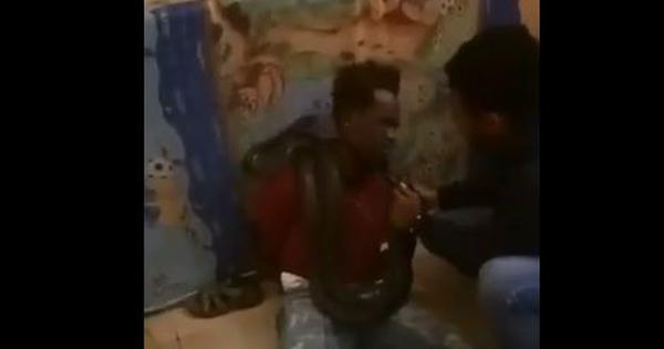 Watch: Indonesian police threaten man with a snake during interrogation