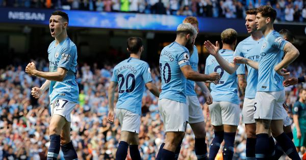 Manchester City bounce back from Champions League exit to edge out Tottenham and lead table