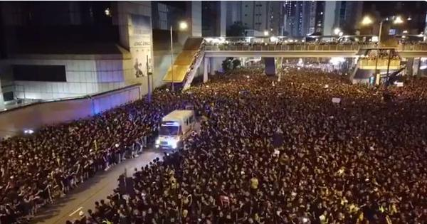 Watch: In Hong Kong, a crowd of nearly two million protestors parts to make way for an ambulance