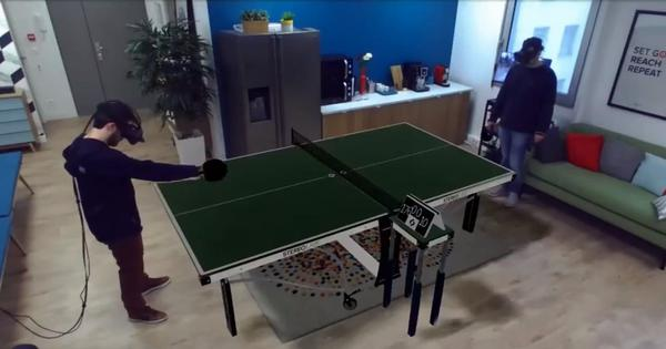 Watch: Two people play ping pong on a table that does not exist