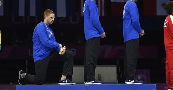 Two USA athletes reprimanded for protesting against Donald Trump on podium during Pan Am Games
