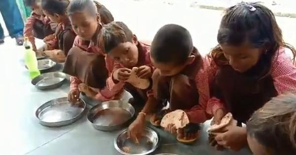 Caught on camera: Schoolchildren in Uttar Pradesh are fed chapatis with salt for mid-day meals