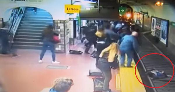 Watch: Man faints at a train station and unwittingly knocks a woman onto the tracks