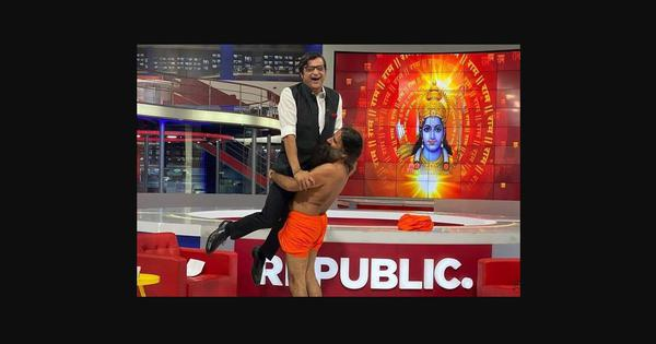 Caught on TV: Yoga guru Ramdev lifts Arnab Goswami off his feet to 'prove his strength'