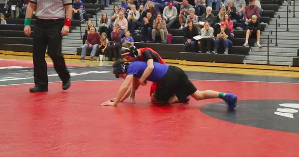 Watch: This teenaged wrestler with cerebral palsy pinned his opponent, who helped him back  up later