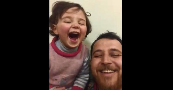Watch: To distract 4-year-old daughter, a Syrian father taught her to laugh every time a bomb drops