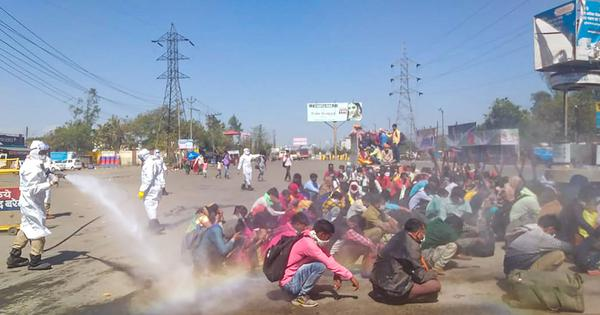 Lockdown scenes: Migrant labourers sprayed with disinfectant meant for sanitising buses in UP