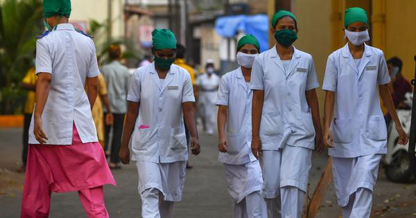 As coronavirus cases rise in Mumbai, its hospitals are grappling with staff shortage
