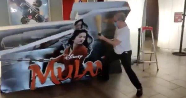 Watch: French theatre owner destroys a poster of 'Mulan' over movie's Disney+ release announcement