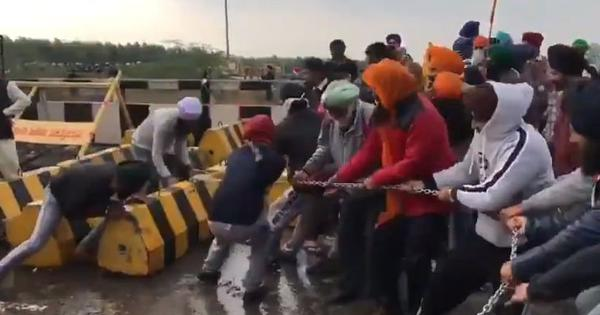 Watch: Protesting farmers are removing police barricades on highways leading to Delhi