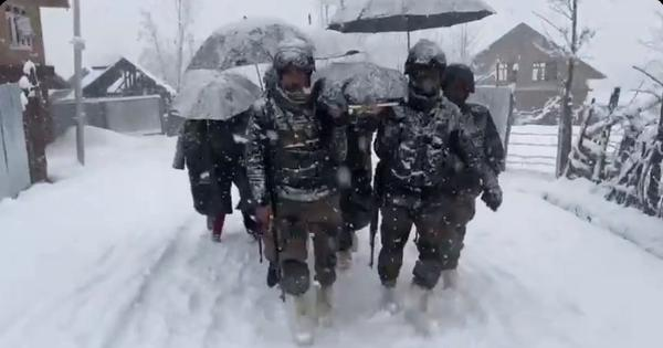 Watch: Army soldiers carry woman, newborn to safety amidst heavy snow in Lolab in Kashmir