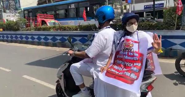 Watch: CM Mamata Banerjee rides pillion on electric scooter to protest against fuel hike