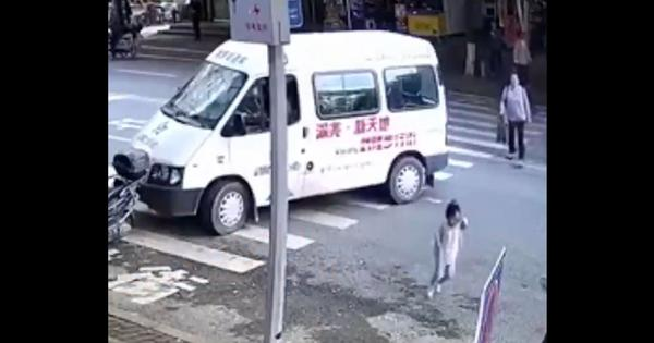 Narrow escape: Van screeches to a halt inches away from toddler running across the street