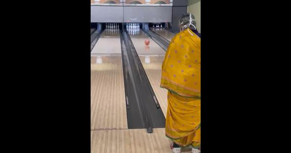 Watch: Woman in sari makes a strike at bowling alley, then adjusts mask