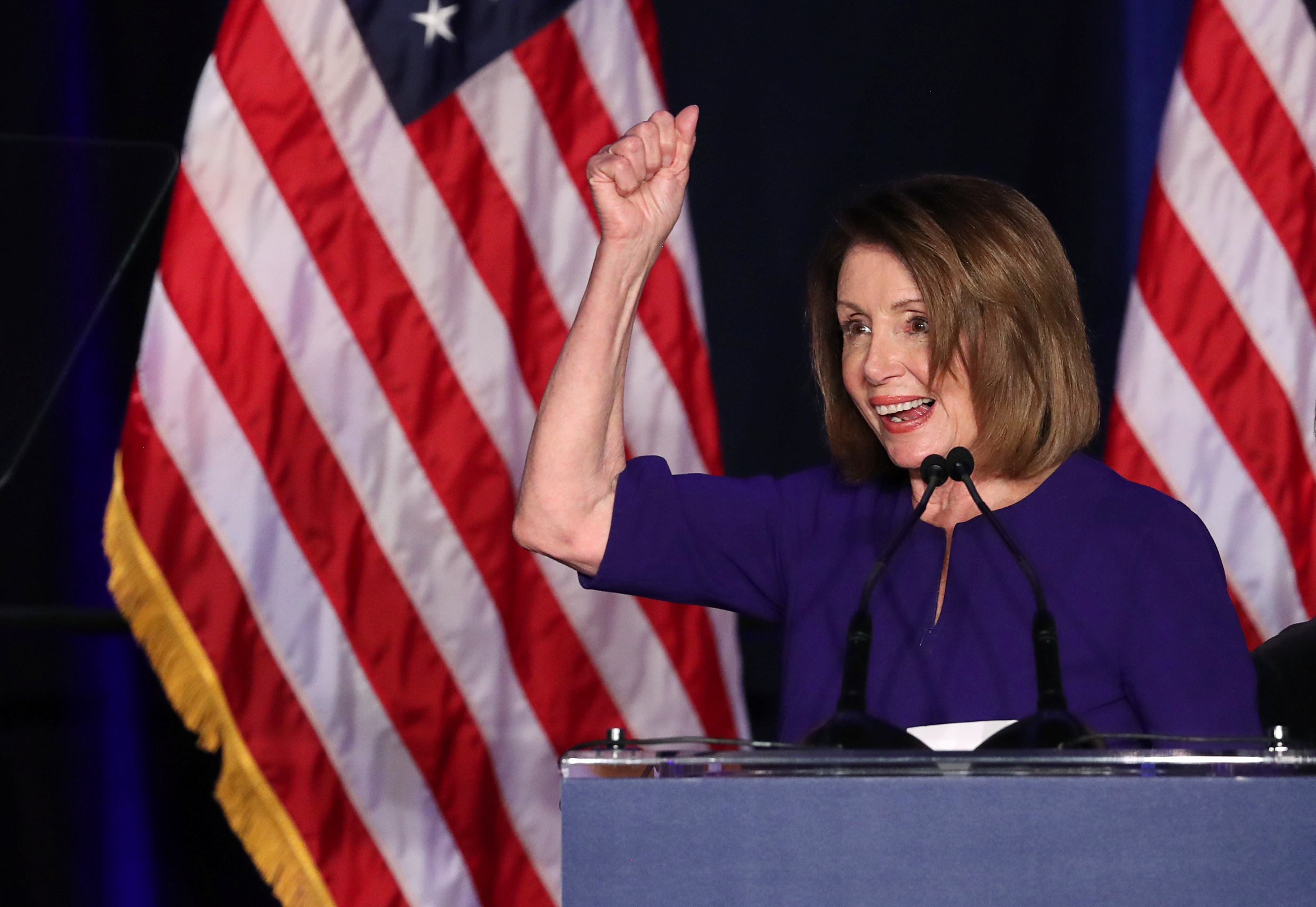Nancy Pelosi, leader of the Democrats in the House of Representatives, celebrates her party's victory in Washington. Photo credit: Reuters