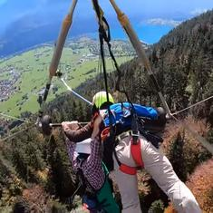Watch: Nail-biting video shows hang glider clinging on for life after pilot forgets to strap him in