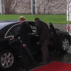 Watch: UK PM Theresa May got locked inside her car as she arrived to meet Angela Merkel
