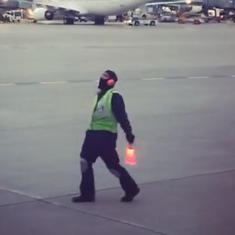 Watch: Airport worker breaks into a dance while signalling on the tarmac