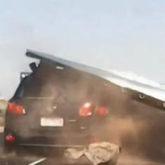 Watch: Driver escapes narrowly after huge highway road sign falls on her car