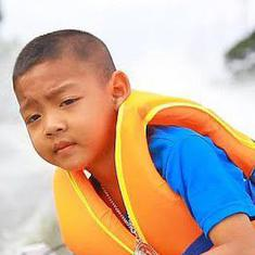 Watch: Five-year-old boy in Thailand gets to school by driving a boat