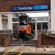 Watch: Construction worker wrecks hotel reception with excavator over alleged wage dispute