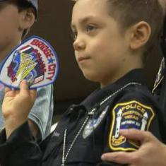 Watch: A terminally-ill child in the US becomes police officer for a day