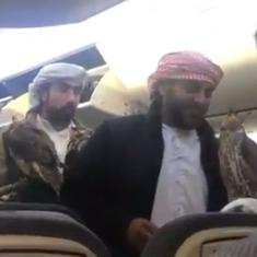Watch: Video of two men carrying 'emotional support falcons' on a plane goes viral