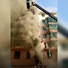 Watch: A 19-year-old crane operator saved 14 people from a burning building in China