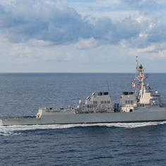 China warns US after American warship sails near disputed territory in South China Sea