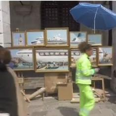 Watch: Artist Banksy crashed the Venice Biennale and set up a street kiosk for his paintings