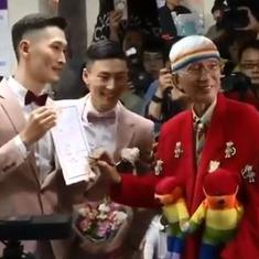 Watch: Couples in Taiwan celebrate legalisation of same-sex marriages by walking down rainbow aisle