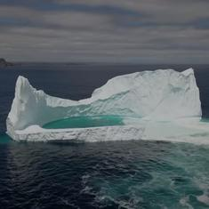 Watch: Drone footage reveals a stunning natural pool formed inside an iceberg in Canada