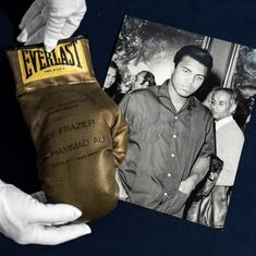 No buyers for Muhammad Ali's autographed gold glove from 'Fight of the Century' against Joe Frazier