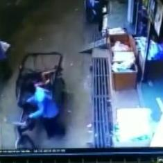 Watch: Child falls off second floor in MP town, escapes miraculously after landing on a rickshaw